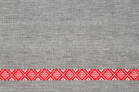 red stripe: detail of grey place mat with red stripe Stock Photo