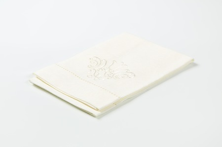 embroidered: white cotton napkin with embroidered ornament Stock Photo
