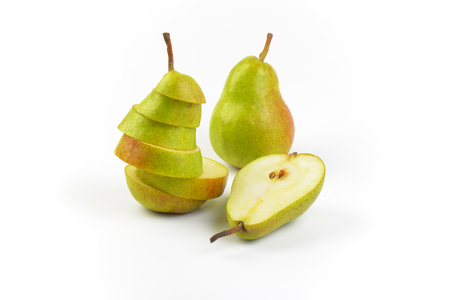 whole, halved and sliced pears on white background Imagens