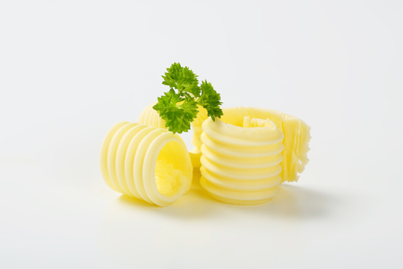 curls: butter curls with parsley on white background