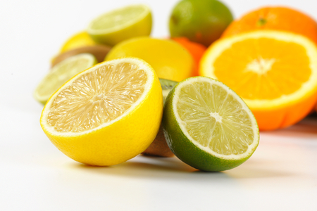 close up of fresh citrus fruit on white background