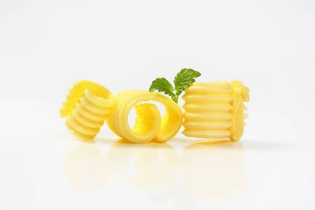 curls: Curls of fresh butter on white background
