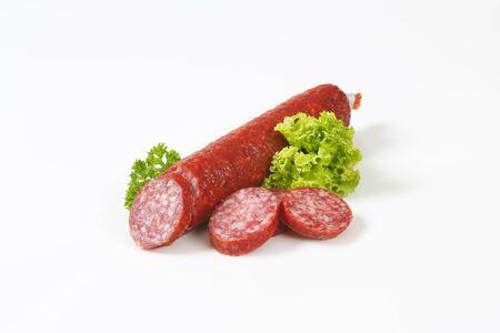 Smoked sausage salami on white background