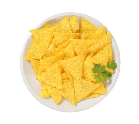 triangle shaped: triangle shaped tortilla chips on plate