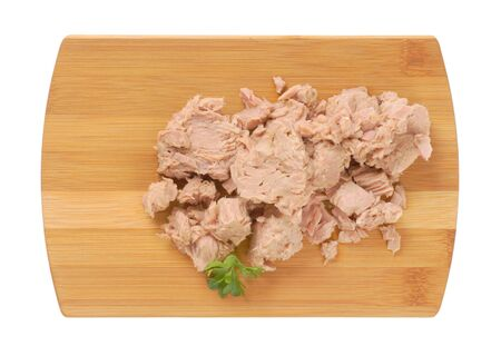 chunks: chunks of canned tuna on cutting board