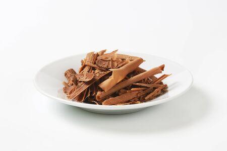 Milk chocolate shavings on white plate Stock Photo