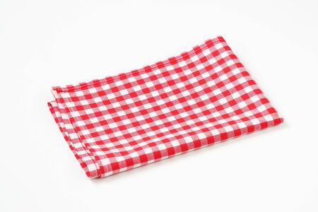 red and white checkered table linen on white background