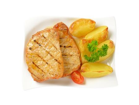 pork chops: Grilled honey glazed pork chops with potato wedges