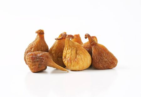 sun dried: sun dried figs on white background Stock Photo