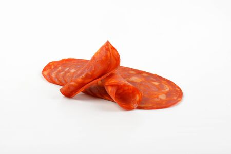 chorizo: slices of chorizo salami on white background
