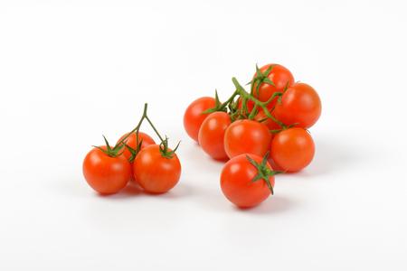 ripe cherry tomatoes on white background Banco de Imagens - 69594813