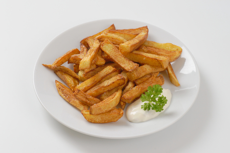 plate of chipped potatoes with mayonnaise