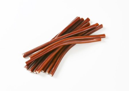 liquorice: Soft and chewy cola flavoured candy sticks with a fondant centre