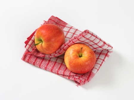 dishtowel: two ripe apples on checkered dishtowel Stock Photo