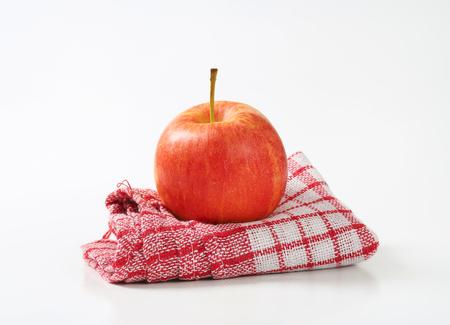 dishtowel: red ripe apple on checkered dishtowel