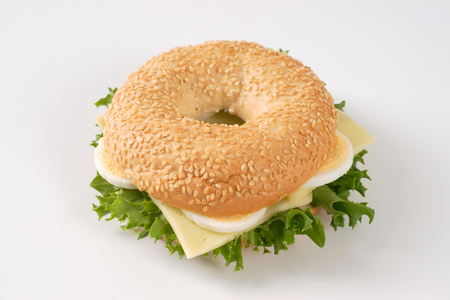 bagel sandwich with egg and cheese on white background Stock Photo