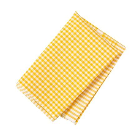 yellow and white checkered tea towel on white background