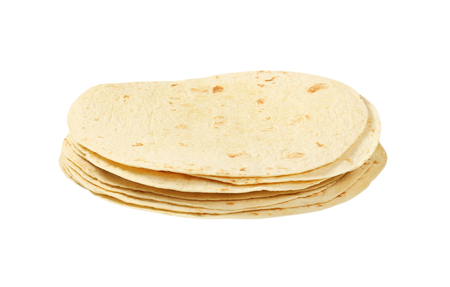 A stack of homemade tortillas on white background