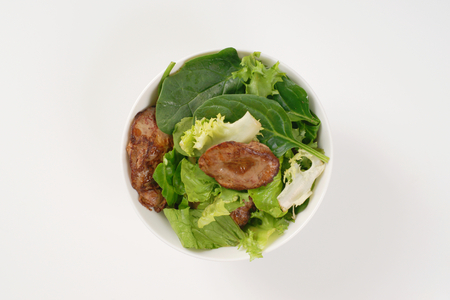 bowl of pan fried chicken liver with salad greens