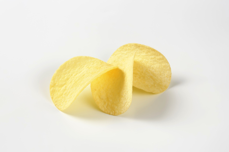 three potato chips on white background