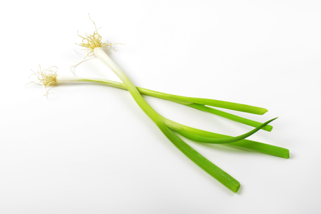 Spring onions (scallions) on white background