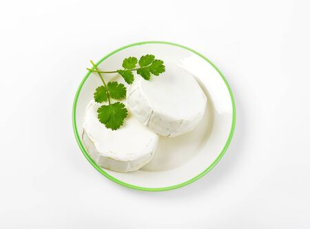 hermelin: Wheels of soft ripened cheese with white mold rind
