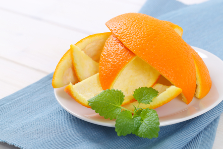 plate of orange peels on blue place mat - close up