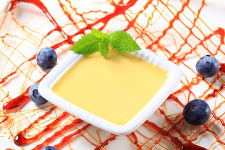 Small dish of vanilla custard and caramelized sugar decoration
