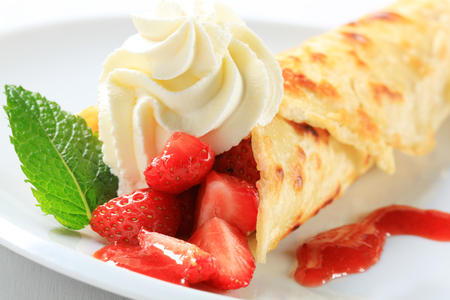 Crepe with fresh strawberries and whipping cream Stock Photo