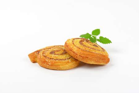 sweet cinnamon rolls on white background