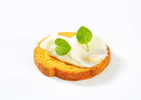Small round toast with cheese spread Stock Photo