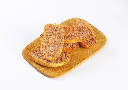 melba: Crisp Melba toast with cinnamon on cutting board