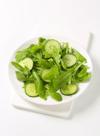 Fresh rocket salad with sliced cucumber