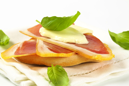 Slices of prosciutto and mozzarella on Friselle bread Stock Photo