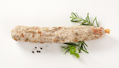 peppercorn: French dry cured sausage with spices on white background
