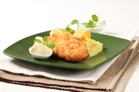 dipping: Fried breaded fish served with mashed potato