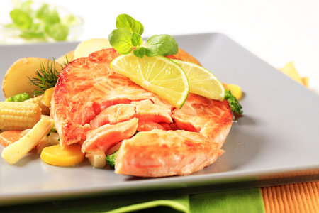 Salmon burger patty with mixed vegetables and potatoes