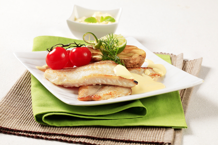 alaska pollock: Pan fried fish fillets with roasted potato Stock Photo