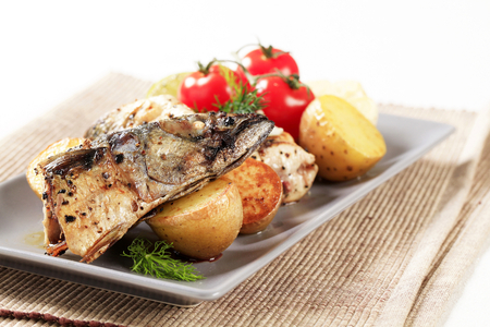 Pieces of crispy spiced mackerel with new potatoes
