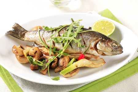 served: Grilled trout served with button mushrooms Stock Photo