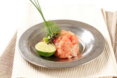 Salmon tartare with lime Stock Photo