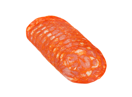 slices of chorizo salami on white background