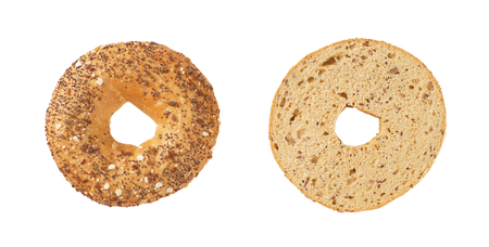 halved bagel with seeds on white background Stock Photo
