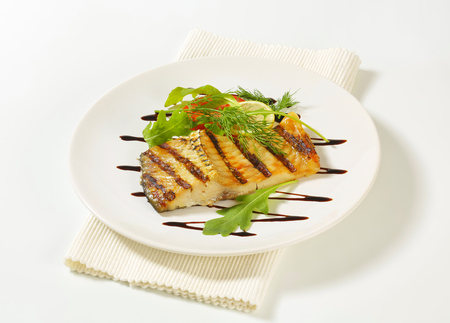 Grilled carp fillet with balsamic vinegar drizzle