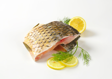 boned: Raw carp fillets with lemon and dill