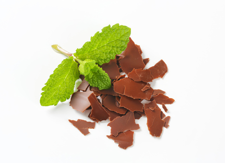 Thin chocolate shavings and fresh mint leaves on white background Reklamní fotografie