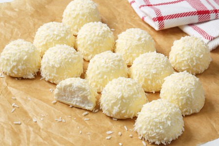 White Chocolate and Coconut Truffles on parchment paper Stock Photo