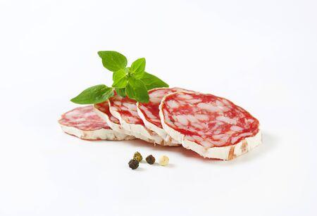 Slices of Saucisson Sec - French dry sausage Фото со стока