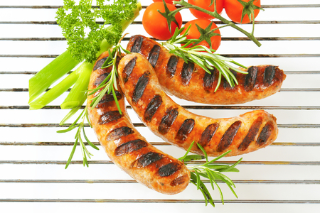 veal sausage: Grilled sausages on barbecue grid Stock Photo