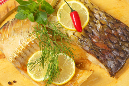 Oven baked carp fillets with lemon and herbs